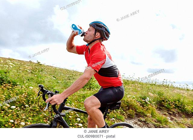 Cyclist stopping to drink