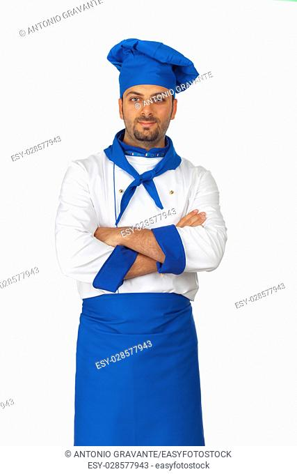 Young chef with blue hat and arms folded