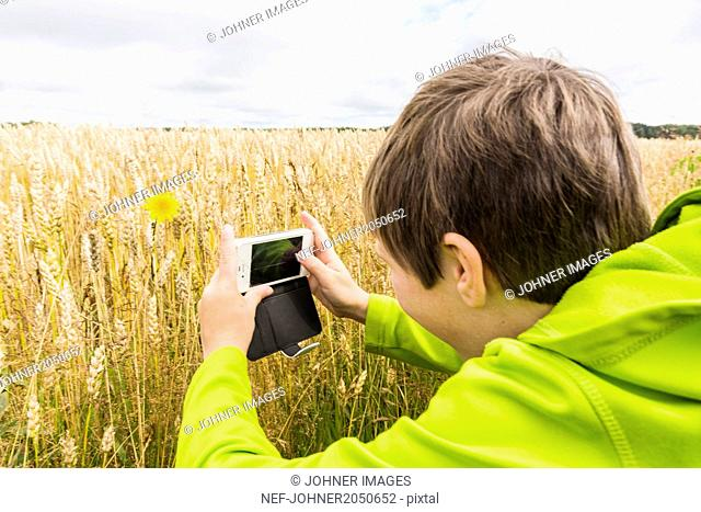 Boy photographing with cell phone