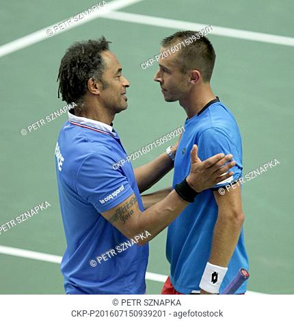 French non-playing captain Yannick Noah (left) congratulates Lukas Rosol of Czech Republic after beating Jo-Wilfried Tsonga of France during the tennis Davis...
