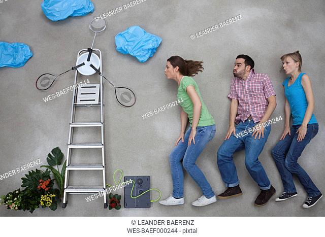 Man and women blowing windmill