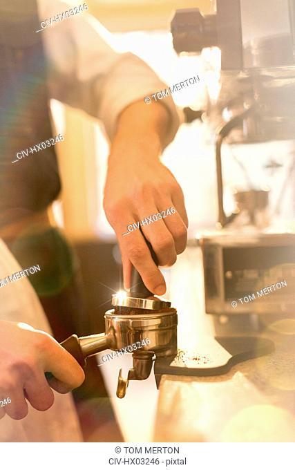 Close up barista pressing espresso, using espresso machine