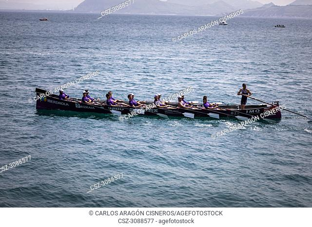 CASTRO URDIALES, SPAIN - JULY 15, 2018: Competition of boats, regata of trainera, Santurtzi Iberdrola boat in action in the VI Bandera CaixaBank competition