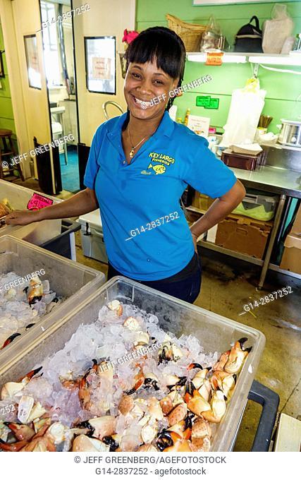 Florida, Upper Florida Keys, Key Largo, Key Largo Fisheries Backyard, restaurant, seafood market, ice display, stone crab claws, packing, plastic bag, Black