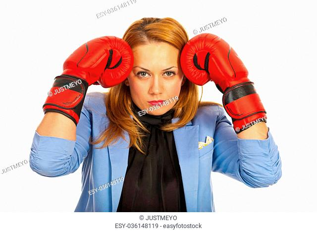 Stressed business woman standing with hands in boxing gloves to head isolated on white background
