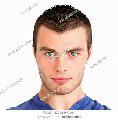 Serious young man looking at camera