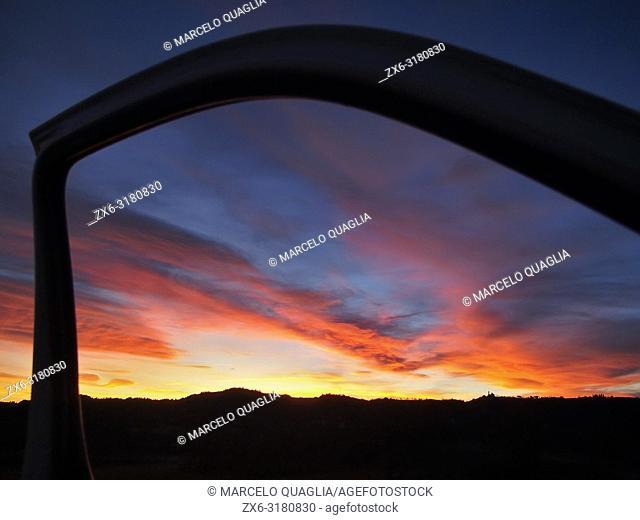 Twilight framed by car door. Lluçanès region, Barcelona province, Catalonia, Spain