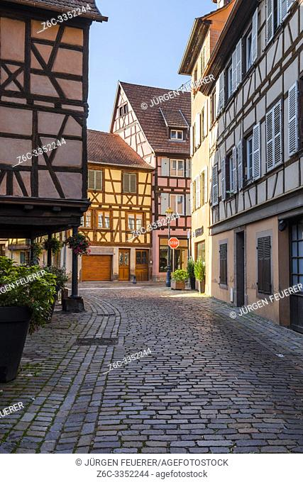 cobblestone street with timbered houses in the village Barr, Alsace Wine Route, France