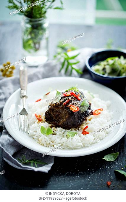 Marinated beef cheeks with chilli on a bed of rice