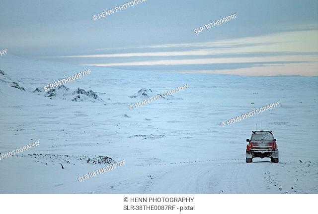 ATV driving in snowy terrain
