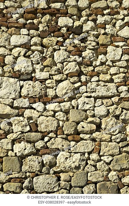 Full frame texture background of an old rubble stone and brick wall construction