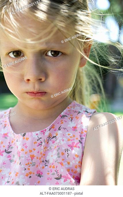 Little girl pulling face
