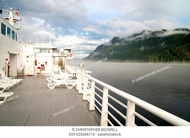 Horizontal composition passenger ferry glides along inland waterway