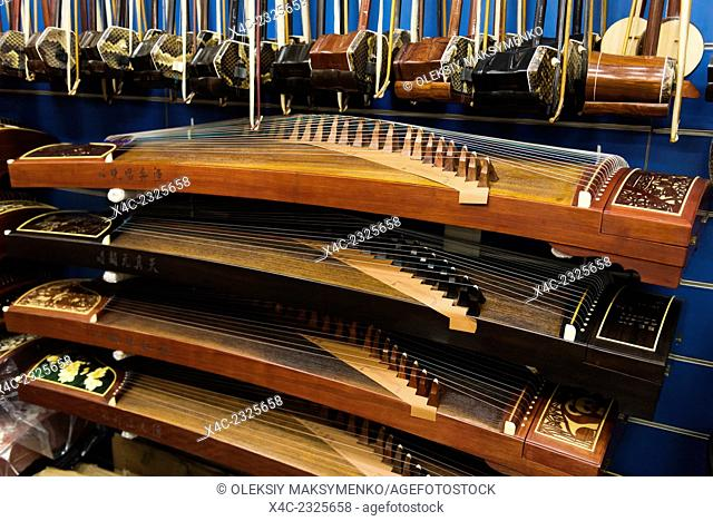 Guzheng, Chinese zither, musical instruments in a store in Shanghai, China