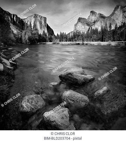 Blurred view of water rushing over rocks, Yosemite, California, United States