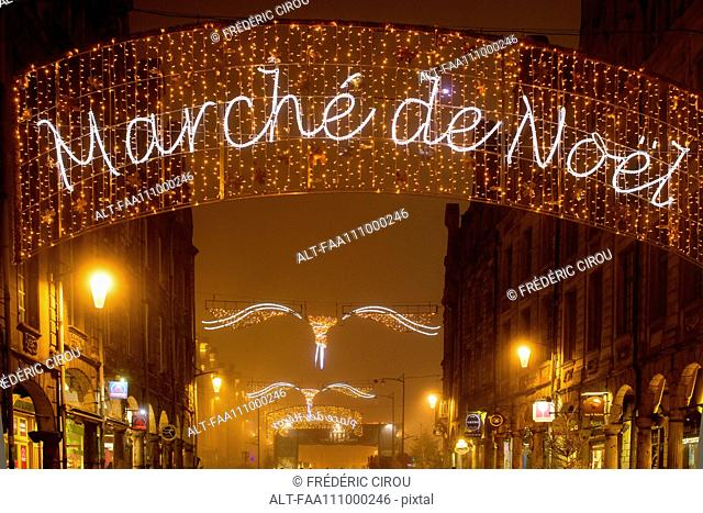 Illuminated sign advertising an outdoor Christmas market in Arras, France