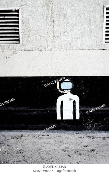 Picture of a diver on a house wall in the city