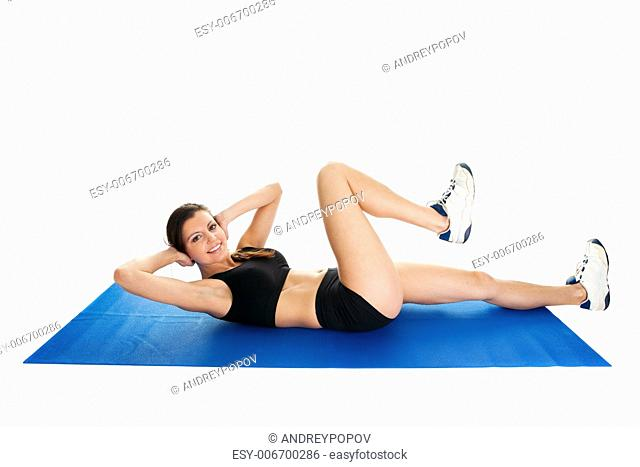 Fitness woman doing crunches on gym mat. Isolated on white