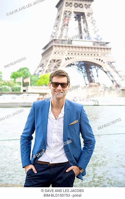 Caucasian man smiling near Eiffel Tower, Paris, France