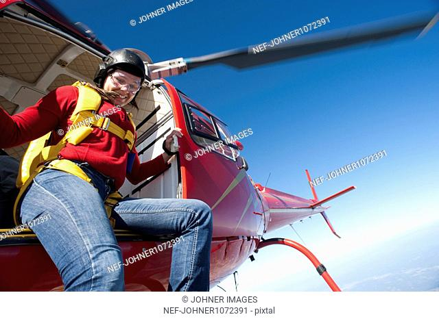 Female skydiver poised to jump