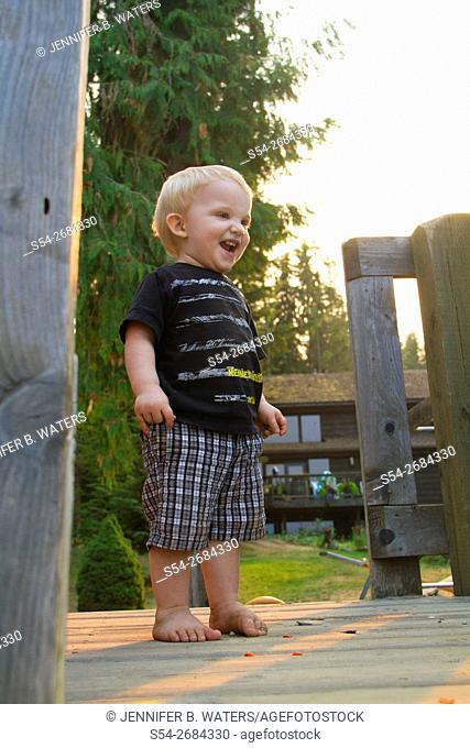 A toddler playing on a playground in Priest Lake, Idaho, USA