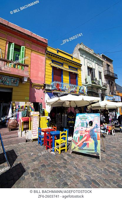 Buenos Aires Argentina La Boca colorful street and buildings for tourists with shops and restaurants with bright primary colors