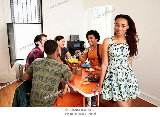 Woman smiling at table with friends