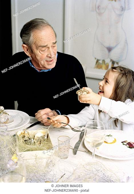 A man and a child at the dinner table