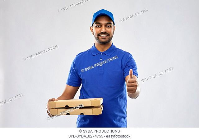indian delivery man with pizza showing thumbs up
