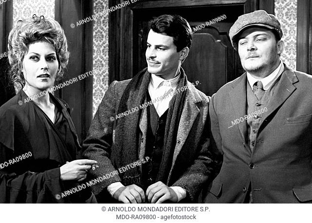 Italian actor Michele Placido looking at actress Annie Carol Edel in The Black Hand. 1973