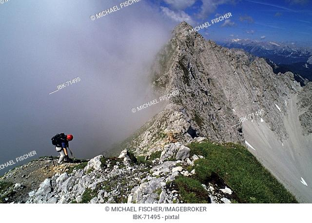 Woman on the via ferrata Innsbruck Austria