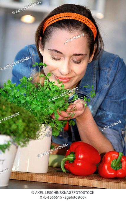 woman cooking with fresh spices