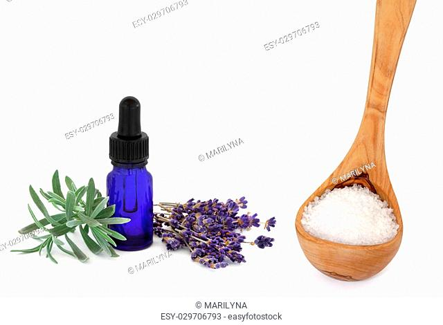 Lavender herb flowers and leaf sprig with an aromatherapy essential oil glass dropper bottle and wooden ladle with sea salt, over white background