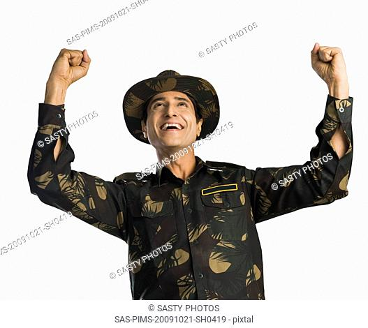 Army soldier cheering with arms raised