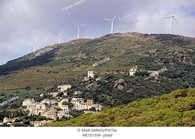 Wind turbines on a mountain top above Rogliano Village, Corsica Island, France