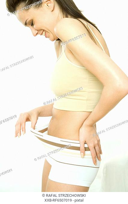 woman checking her belly