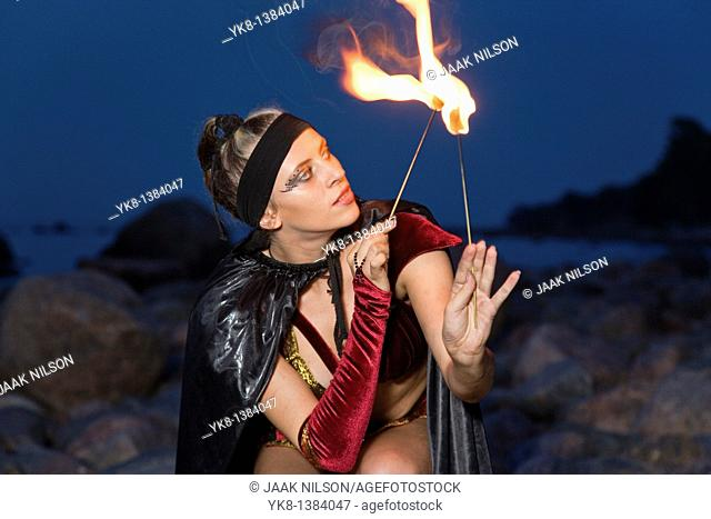 Fire Dancer Woman Fire Dancer in Costume Juggling Torches
