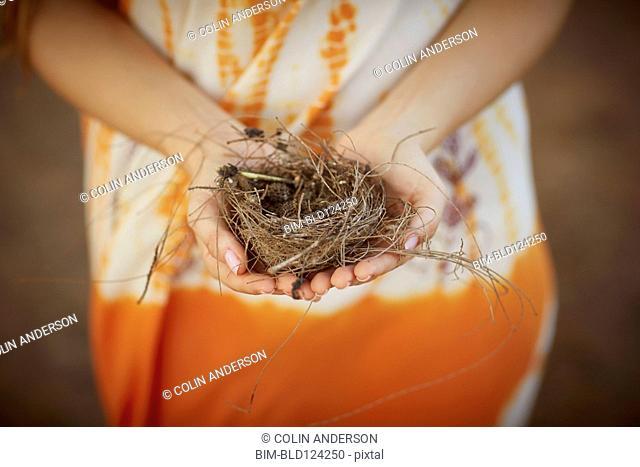 Caucasian woman holding bird's nest