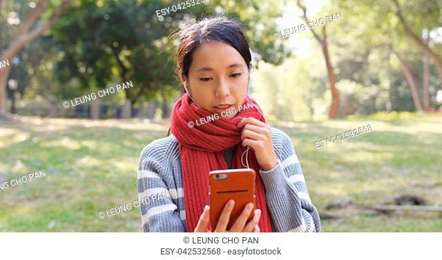 Woman talk to smart phone at park