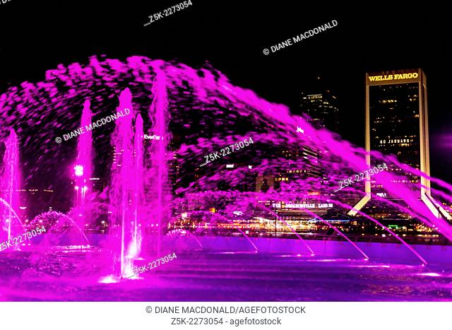 Friendship Fountain, Jacksonville, Florida, USA at night. Across the river can be seen downtown Jacksonville and the Jacksonville Landing
