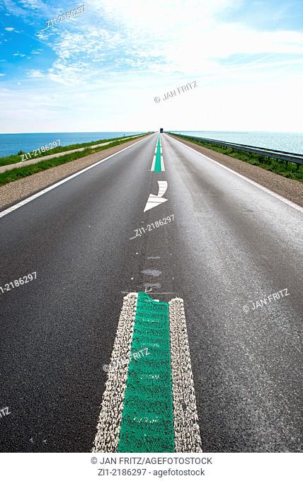 empty motorway on dike