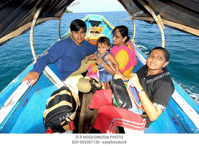 Couple with baby and grandmother travelling by boat ; Andaman Islands ; Bay of Bengal ; India MR736J;736K;736L;364 2008