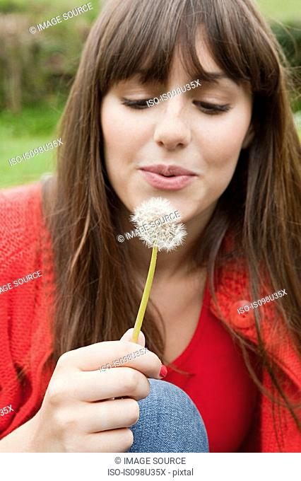 Young woman with dandelion clock