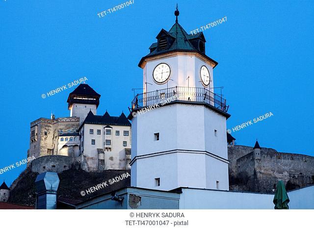 Illuminated clock tower at dusk