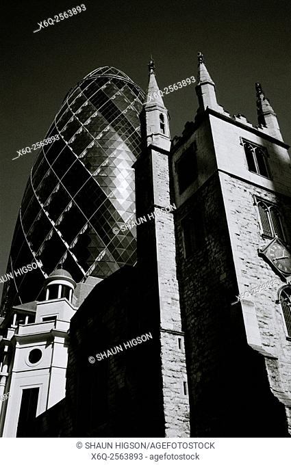 The Gherkin 30 St Mary Axe and St Andrew Undershaft in the City of London in England in Great Britain in the United Kingdom UK Europe