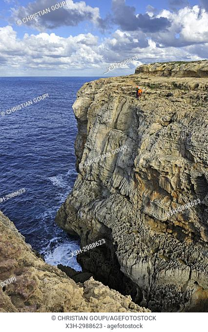 climbers at Wied Il-Mielah on the northwest coast of Gozo Island, Malta, Mediterranean Sea, Southern Europe