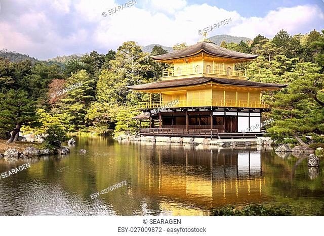 A viewpoint of the Golden Pavilion, or Kinkaku, with a reflection of the building and gardens over the pond at the Rokuonji complex on the outskirts of Kyoto in...