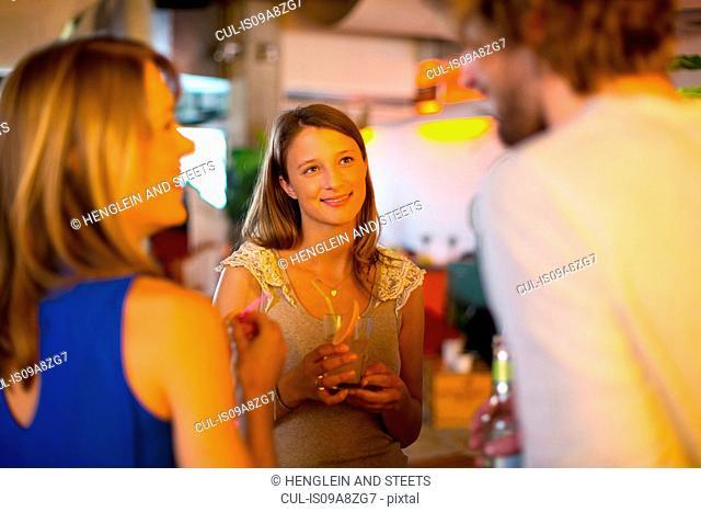 Friends enjoying drinks together in bar