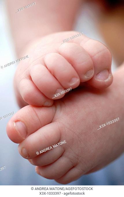 Newborn baby curled up feet