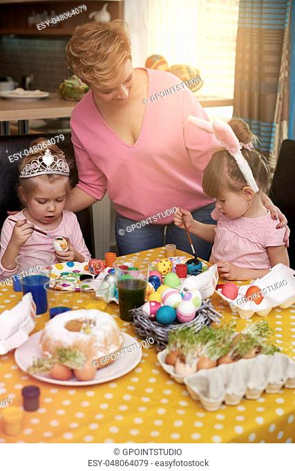 Toddler girls affectionated with easter eggs